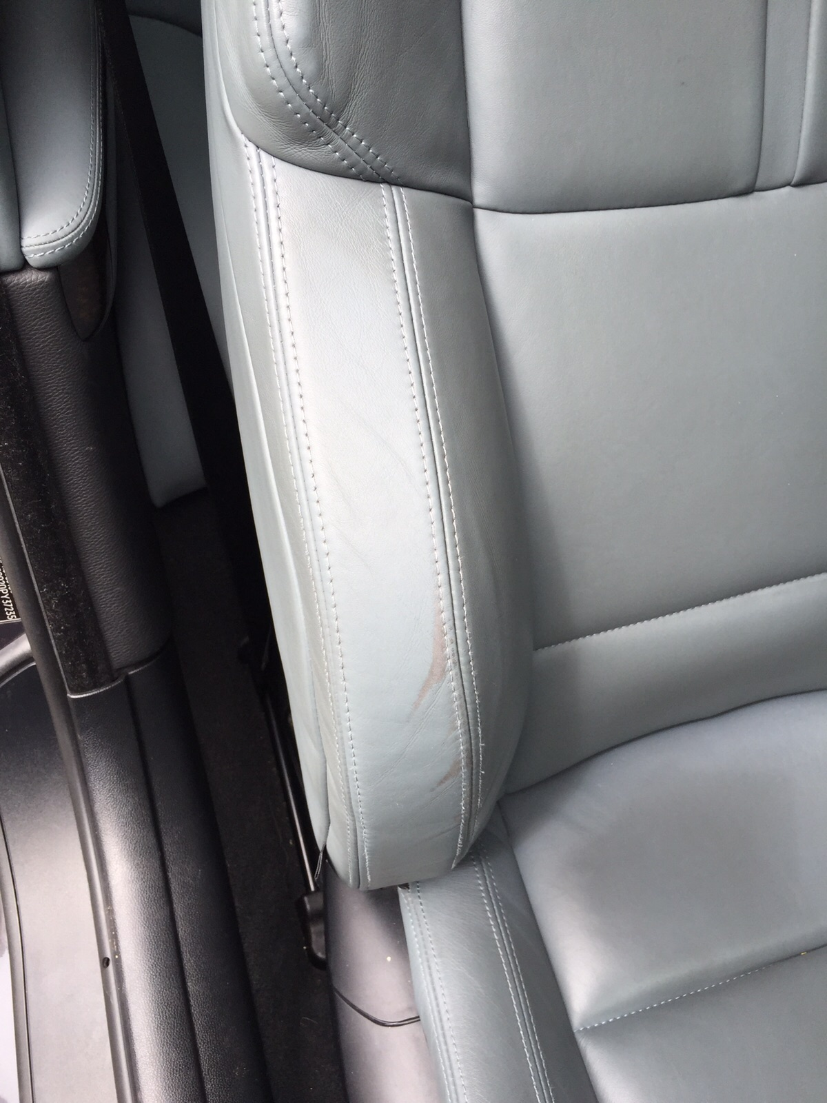 Drivers seat bolster has small areas of scuffing from getting in and out of the car.