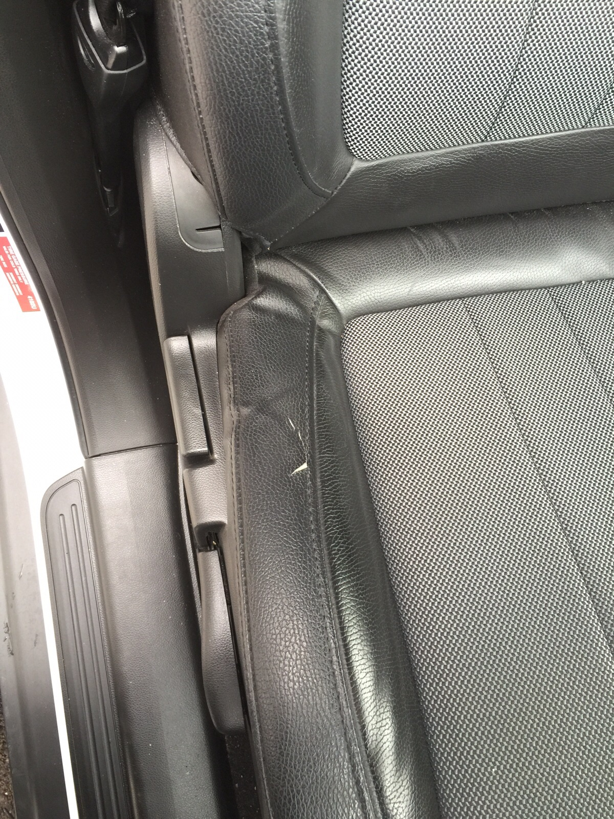 Drivers seat bolster has small area where the leather has started to split.
