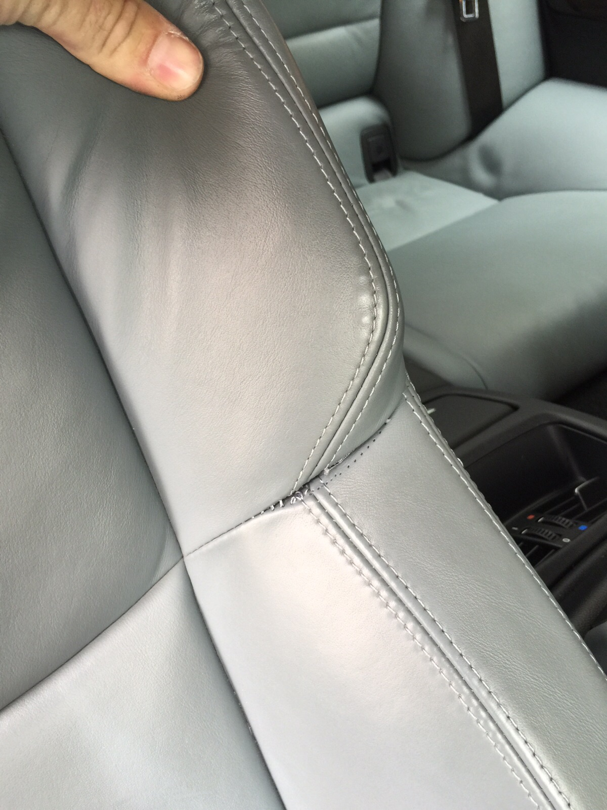 Drivers seat has burst stitching on the shoulder of the seat.