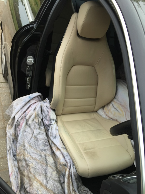 Mercedes car seat has wear and tear and colour loss.